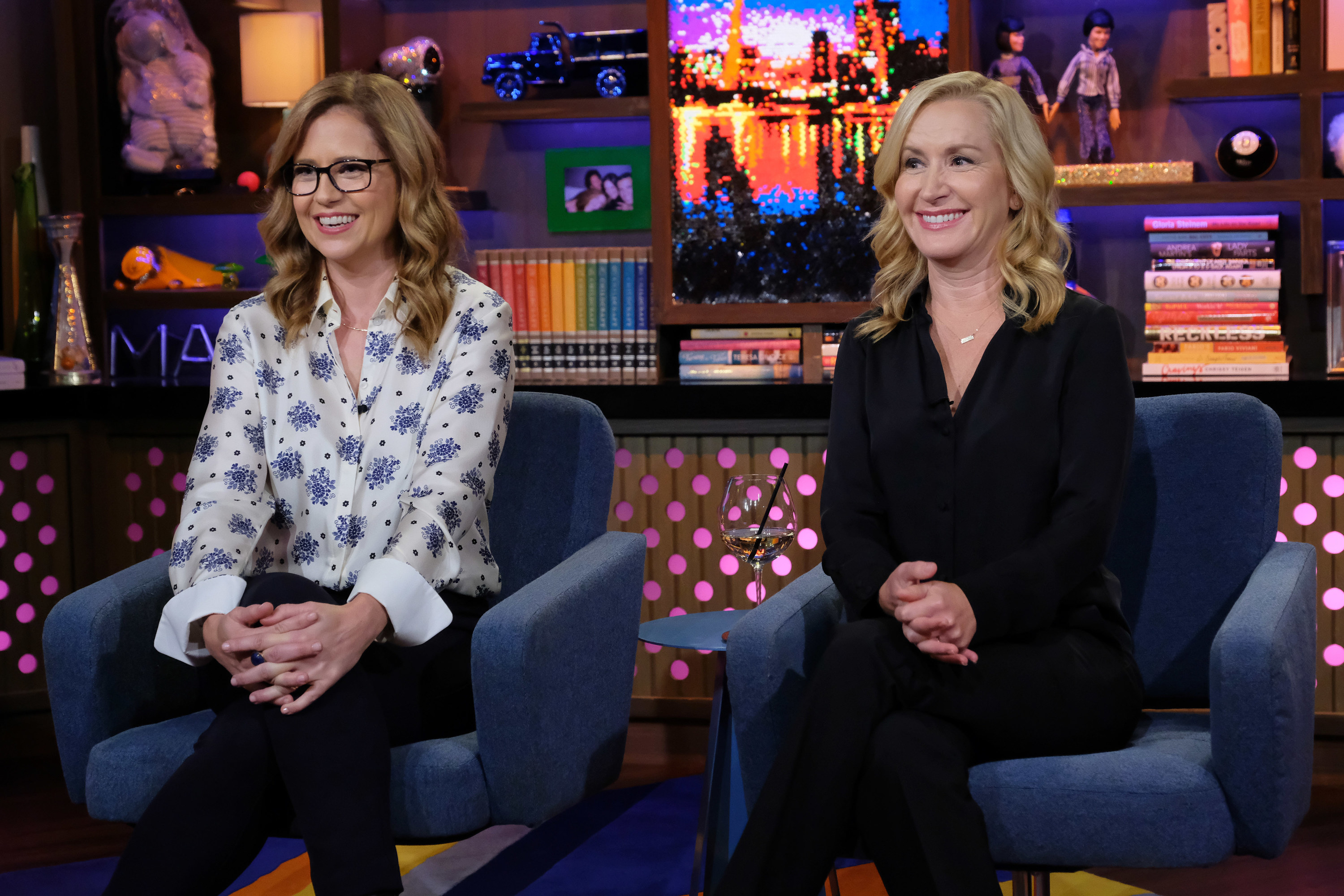 Jessica Fischer and Angela Kinsey sit next to each other while appearing on Watch What Happens Live With Andy Cohen