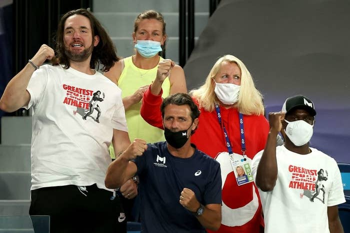 Alexis Ohanian and coach Patrick Mouratoglou cheer on Serena Williams against Romania's Simona Halep during their women's singles quarter-final match on day nine of the Australian Open tennis tournament
