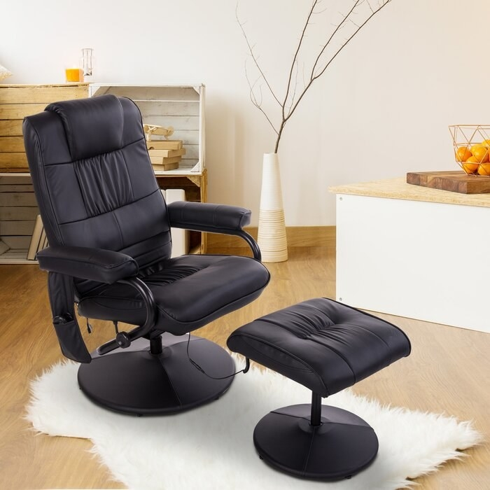 The black faux leather massage chair