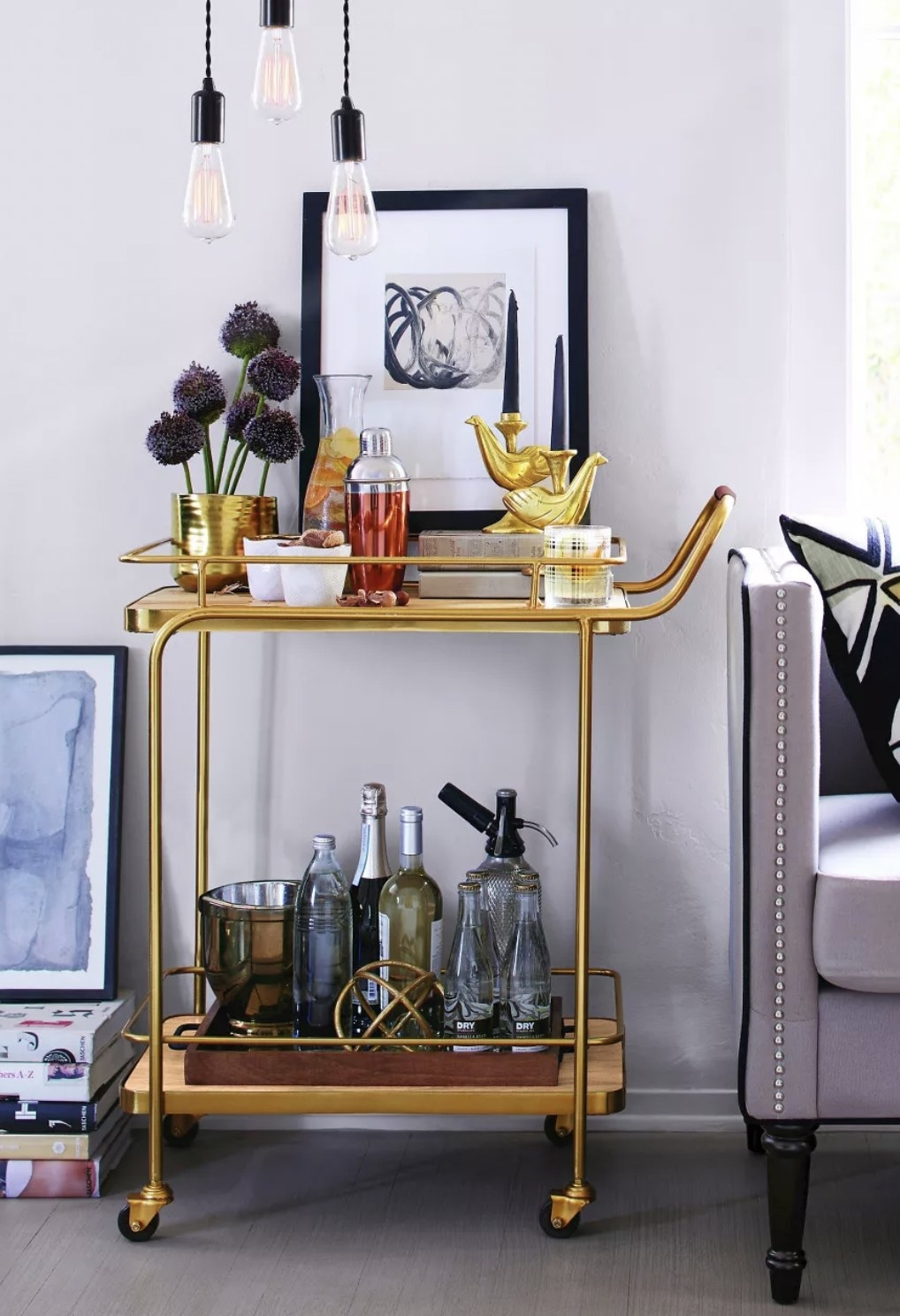 a gold push cart bar cart with two tiers and wheels