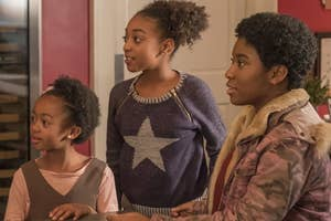 This Is Us characters Annie, Tess, and Deja at a kitchen counter