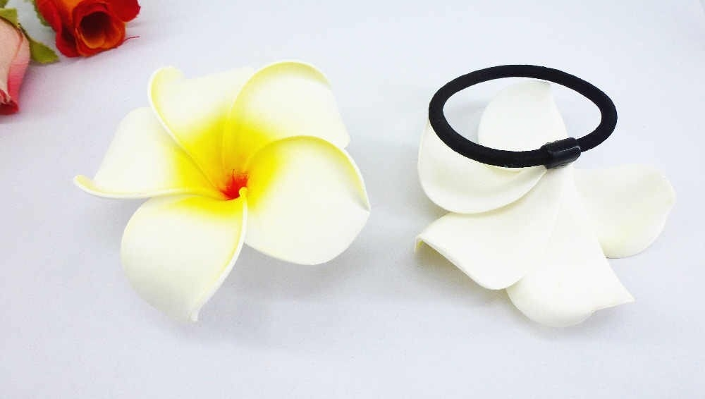 Frangipani fake flowers tied attached with a thick hair tie