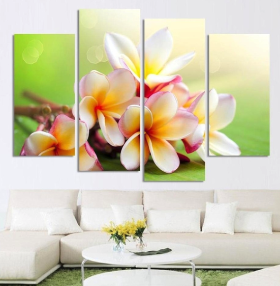 Close up of a bunch of frangipani flowers which have been cut into four different canvases