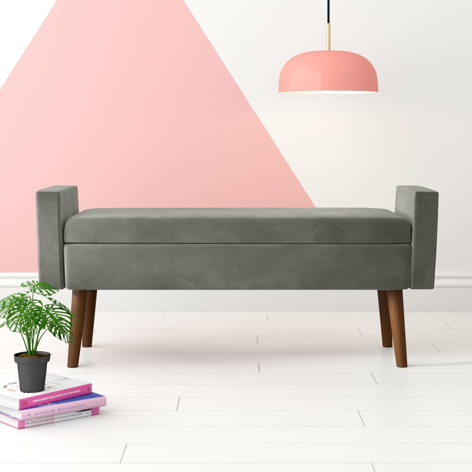 The bench, which has an open back, arm rests on either side, and wooden legs, in gray
