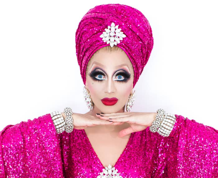 Photo of Bianca wearing a magenta sparkly caftan with matching turban
