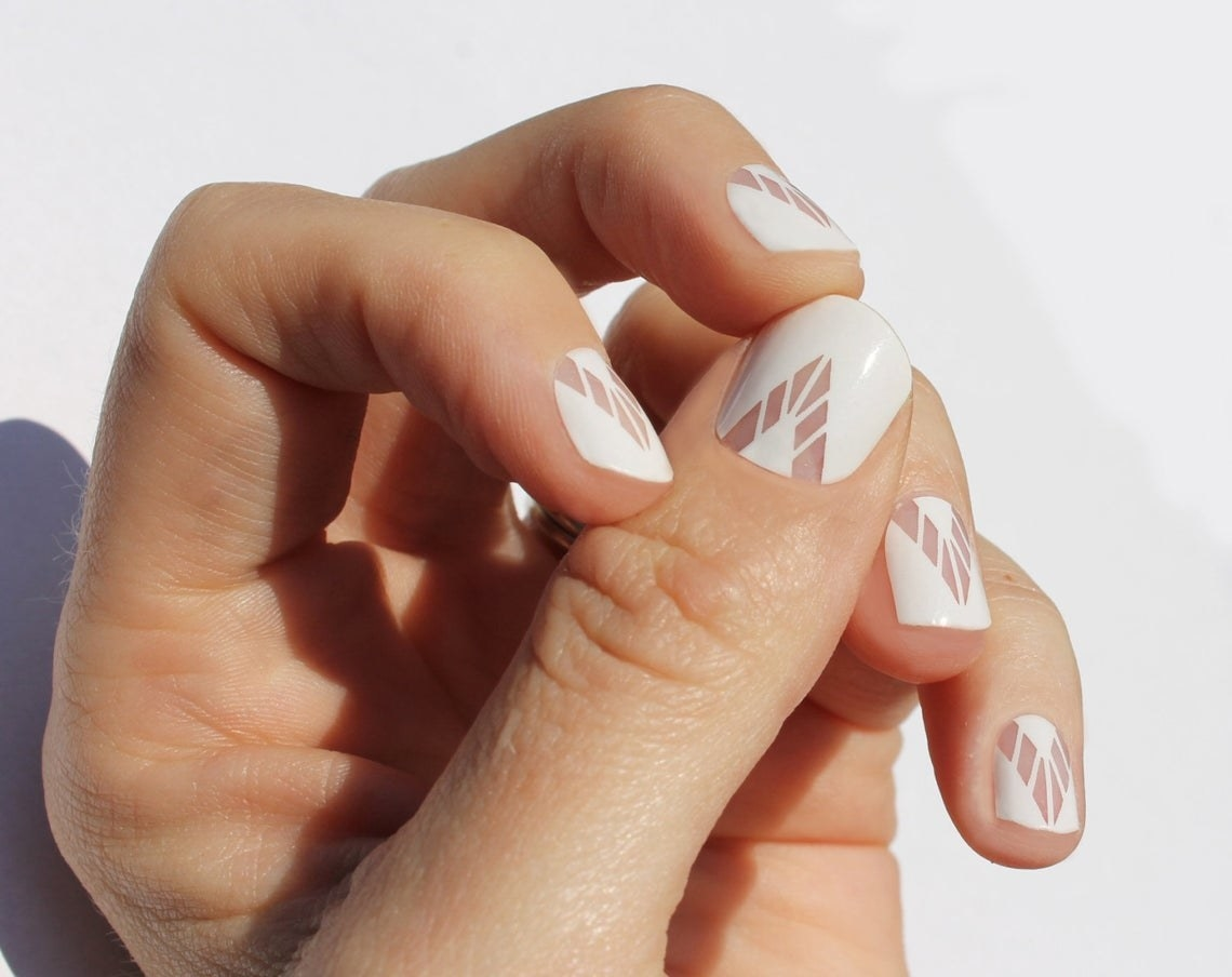 A hand showing the nail wrap design