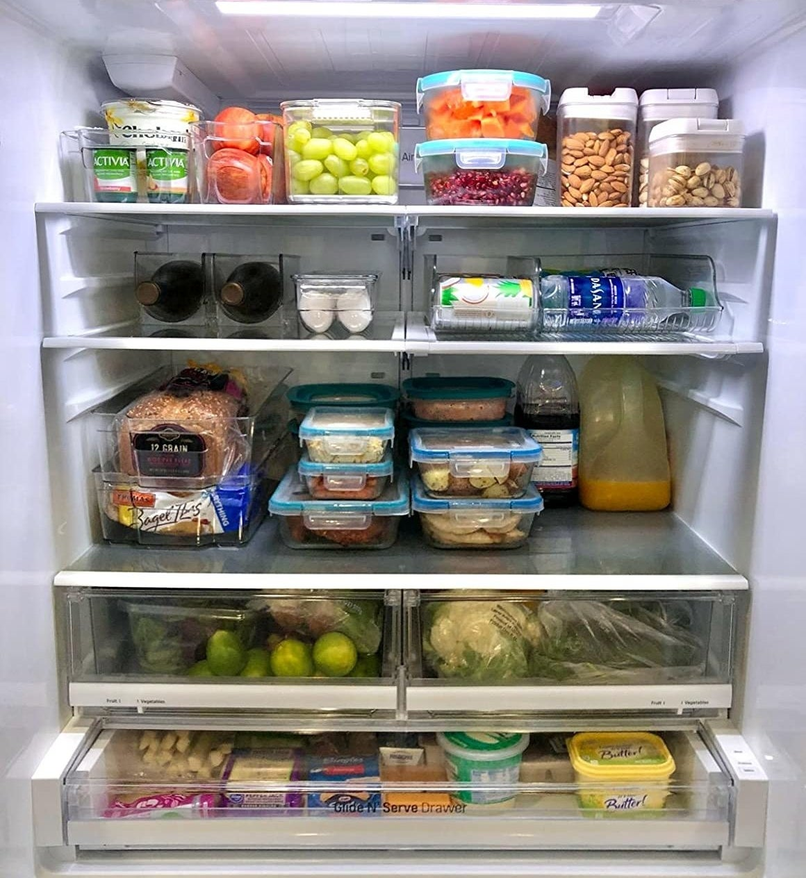 Reviewer photo showing the inside of a fridge organized using the bins