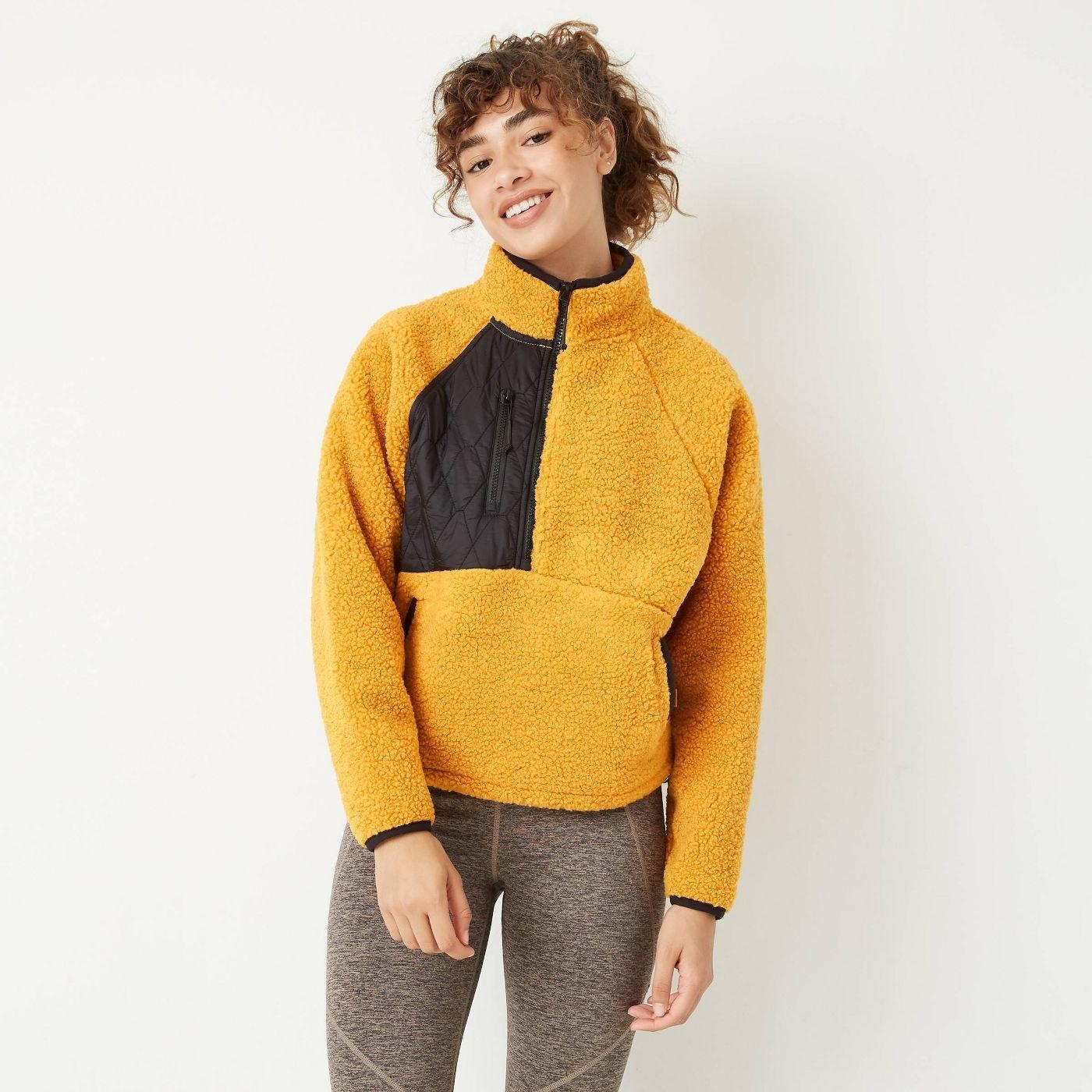 model wearing yellow and black fleece