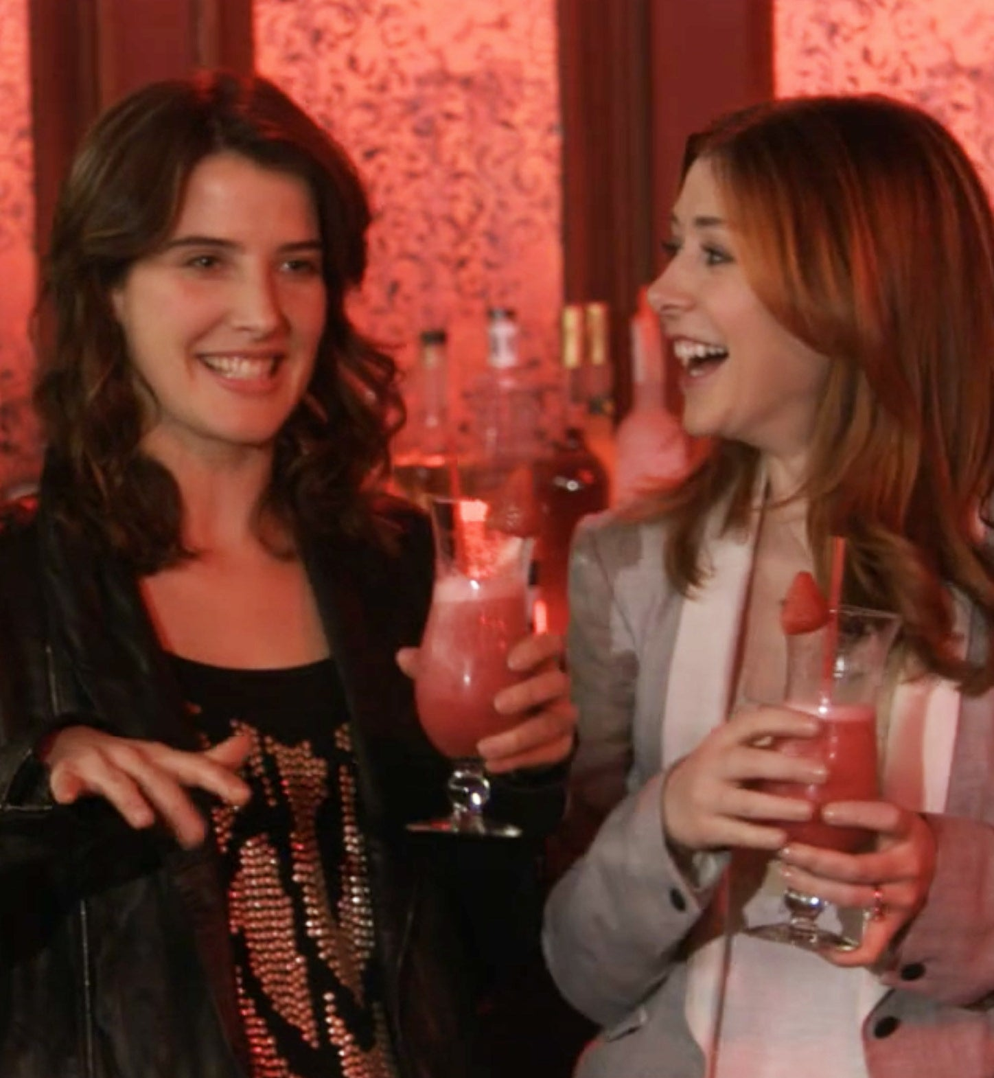 Robin and Lily having a drink at a bar in How I Met Your Mother