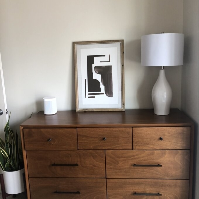 Reviewer's picture of the dresser, which has small splayed legs, four large drawers, and three smaller top row drawers