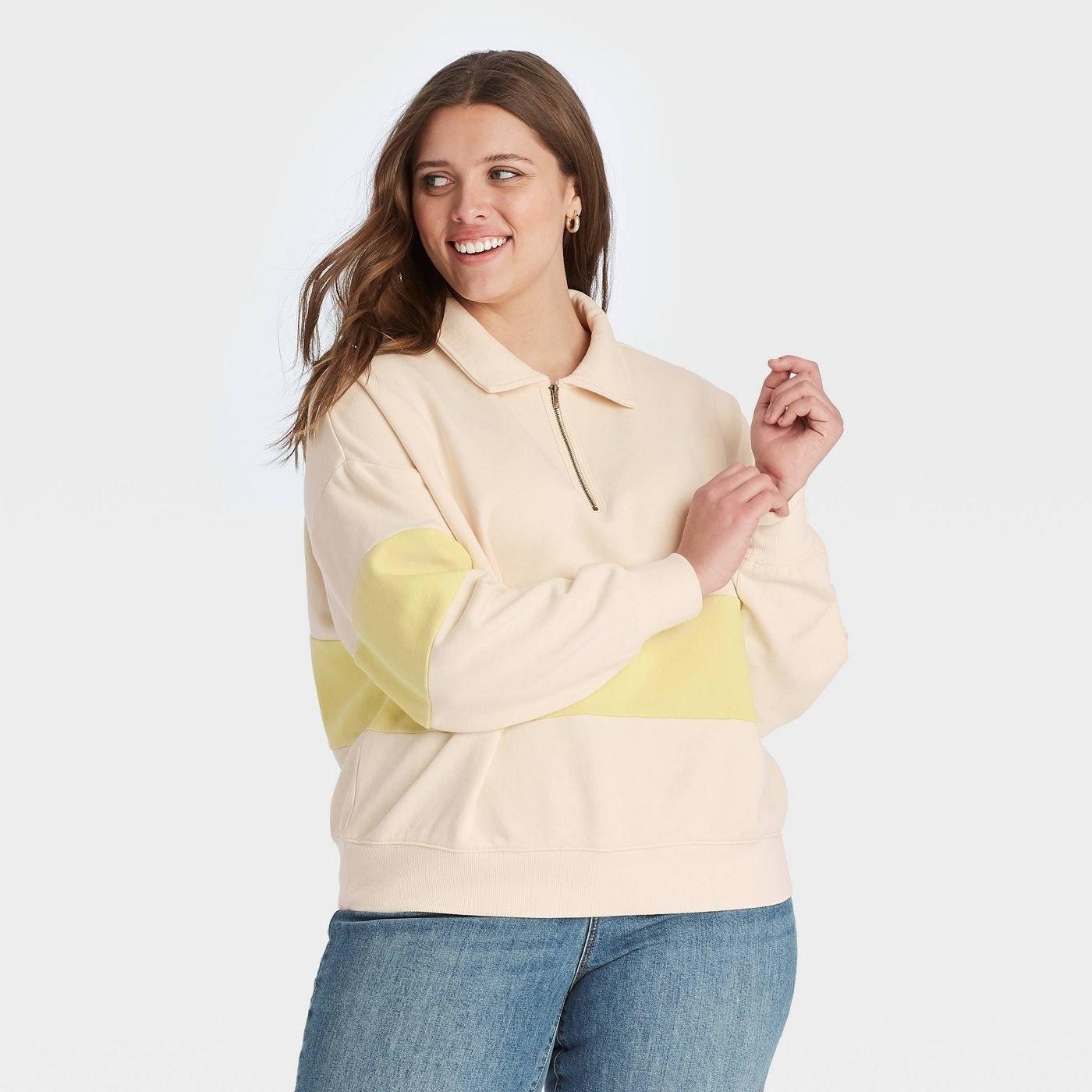Model in Quarter Zip-Up High Neck Pullover Sweatshirt in yellow colorblock