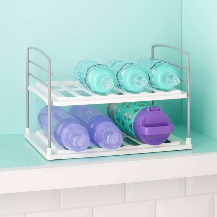A 2-tier water bottle shelf with waterbottles placed inside