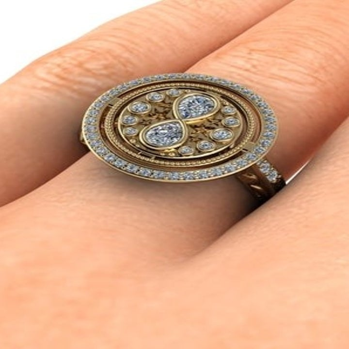 A hand wearing the ring