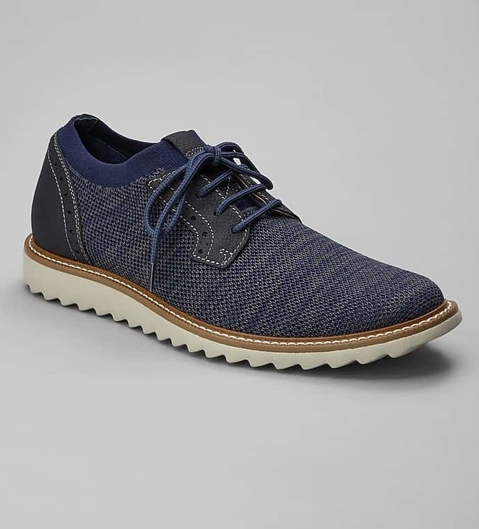 the blue knit sneaker with blue laces and white scalloped sole