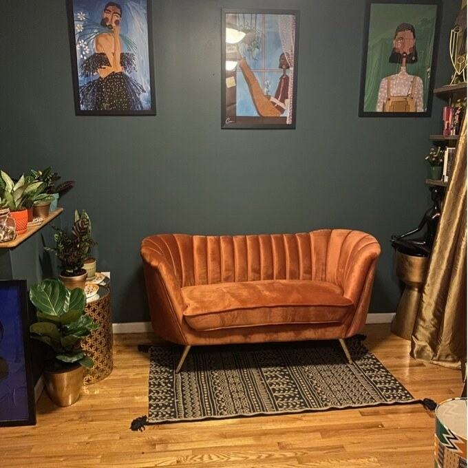 """Reviewer's picture of the loveseat, which has a back that wraps around the sides and slightly into the front, in almost a """"C"""" shape"""