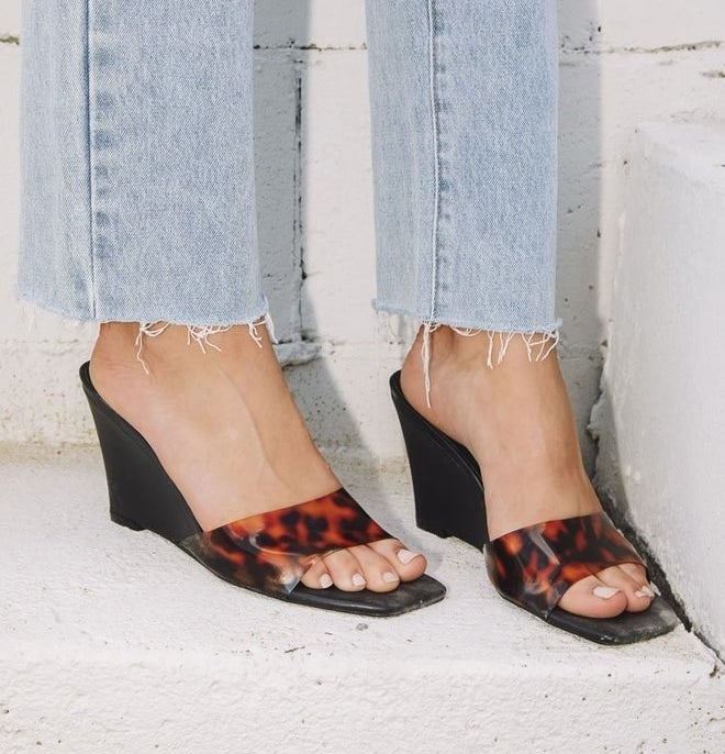 the black wedge heels with brown and black tortoise opaque strap across the toes