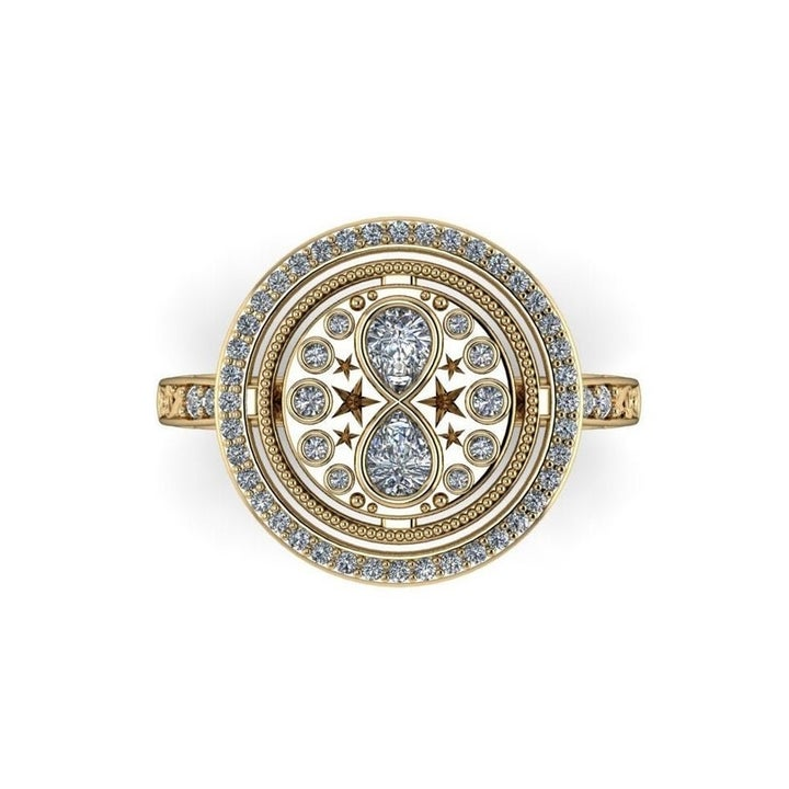 A closeup of the round ring with pave diamonds and an hourglass motif in the center