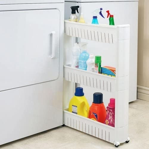 The roll-out storage shelf between a tight space in a laundry room