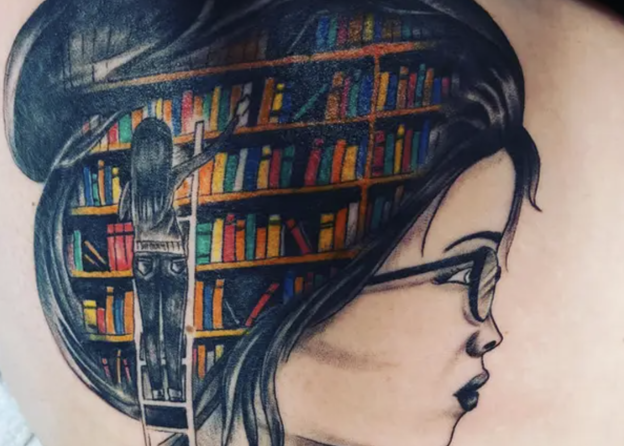A tattoo of a woman's head with a library of books inside