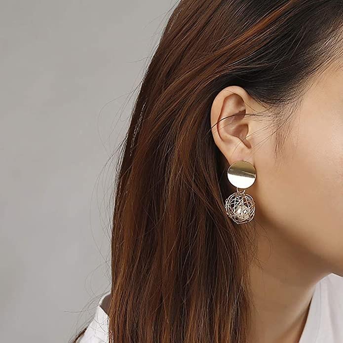 Gold drop earrings.