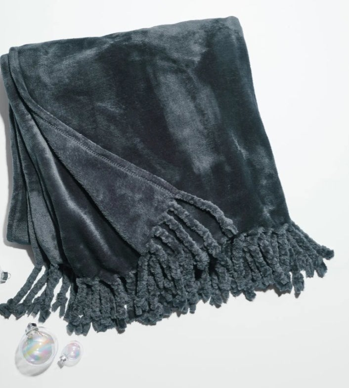 The plush throw in navy blue