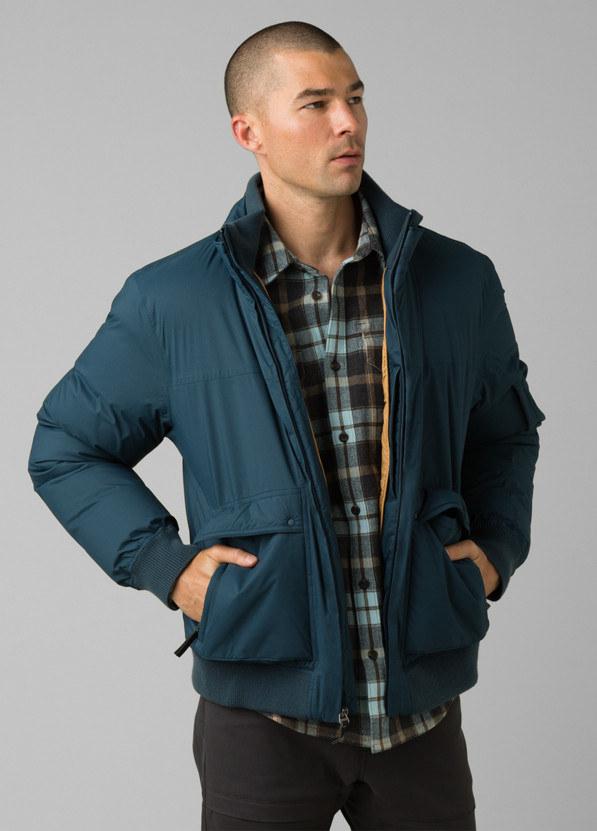 model in teal coat