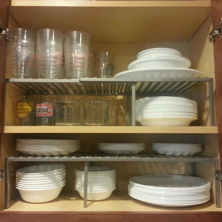 Reviewer showing a two shelf cabinet transformed to four with the expandable shelves