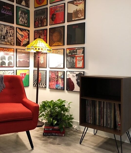The audio rack, which has one large shelf to vertically store vinyl records, a smaller shelf for audio equipment or other related items, and hairpin legs