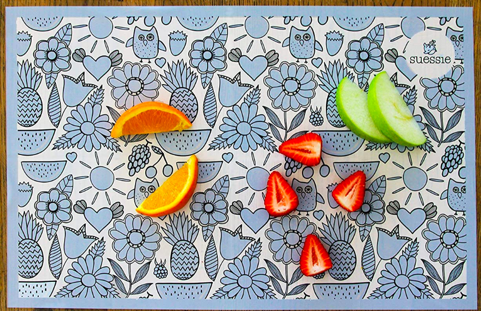 Patterned rectangular placemat with sliced fruit on top