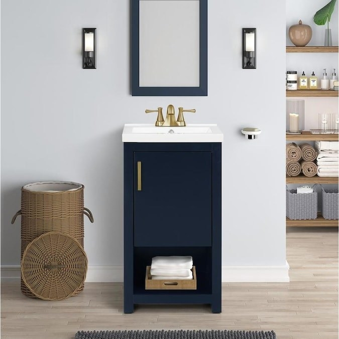 narrow navy, white, and gold sink vanity