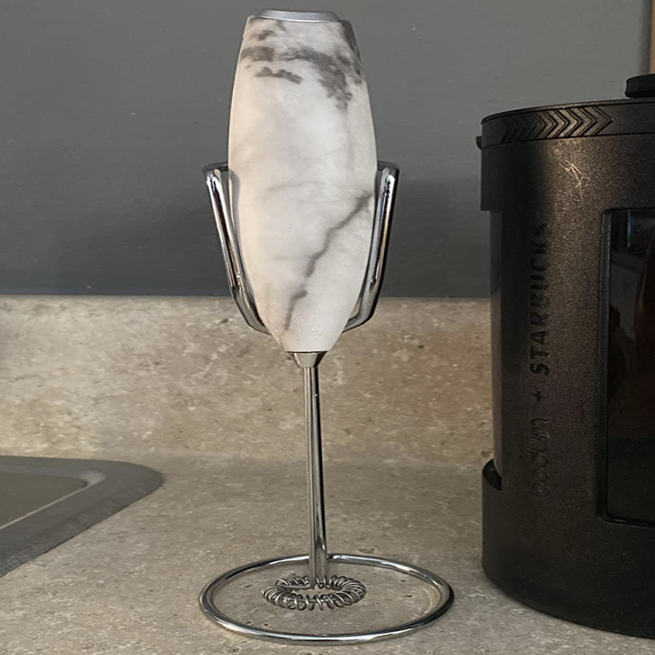 Reviewer image of white marble handheld frother on its stand