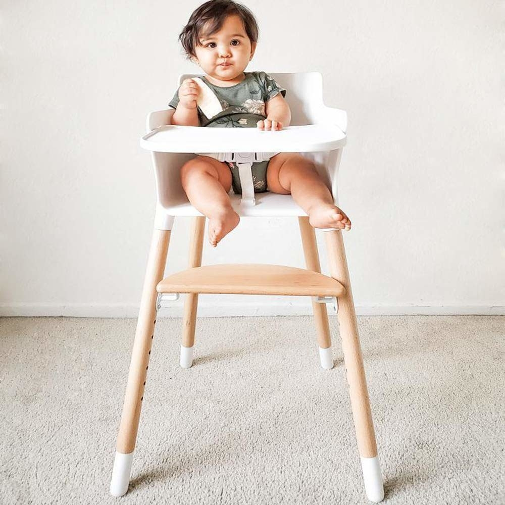 Natural wood and white plastic high chair