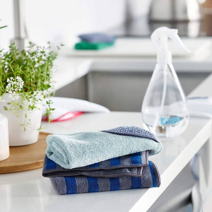 A stack of folded wash cloths on a table