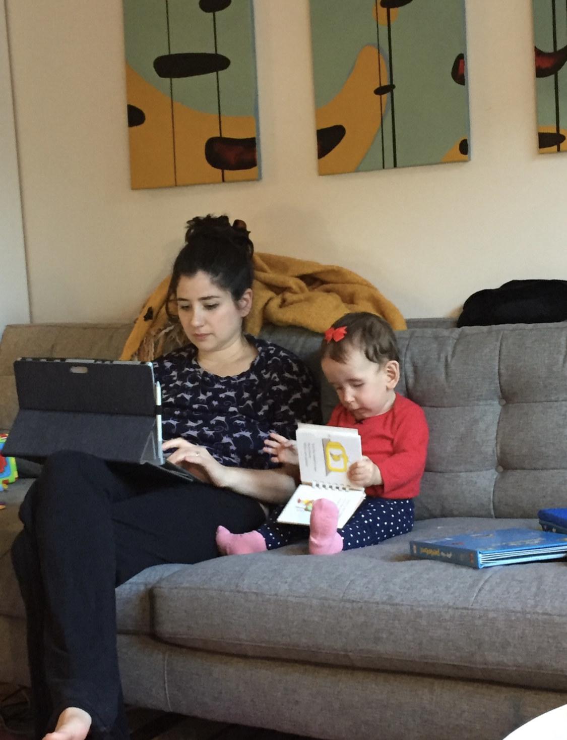 Loryn and Dalia working on computers