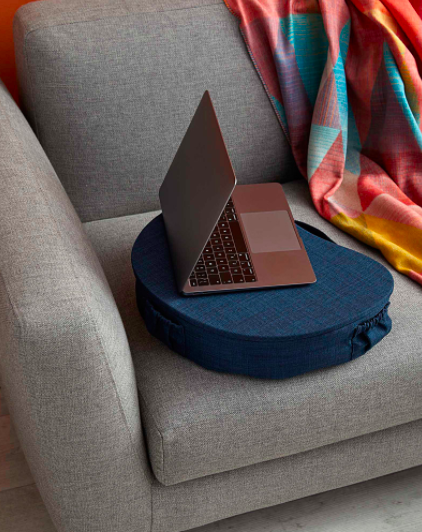 A laptop perched on the padded laptop shelf