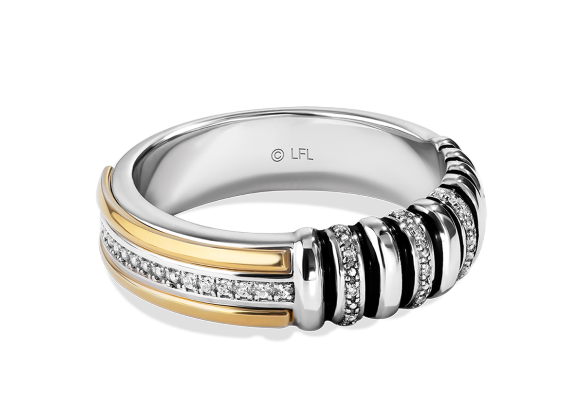 A gold and silver ring detailed with shapes from the hilt of a lightsaber and detailed with white diamond