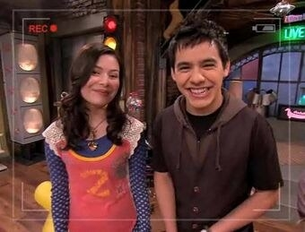 """David Archuleta stands next to Carly during an """"iCarly"""" web show"""