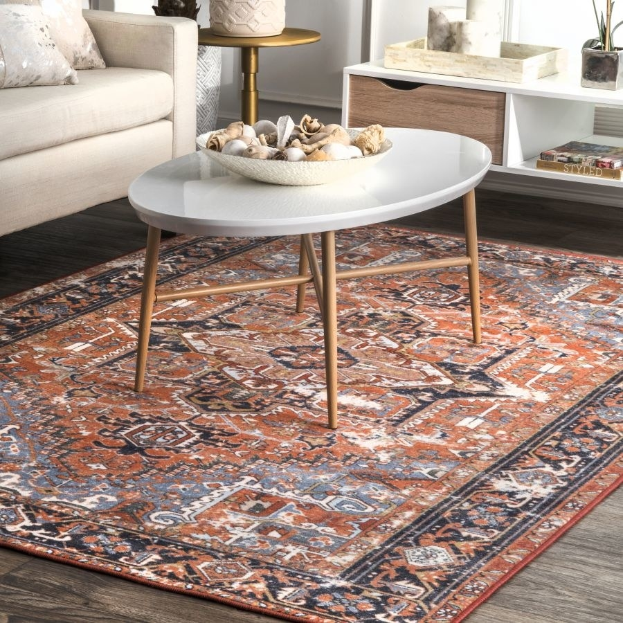 orange patterned area rug