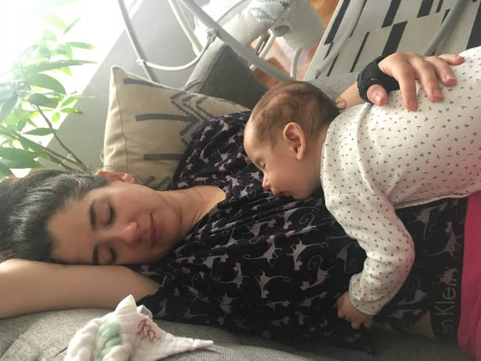 Loryn and baby sleeping on couch