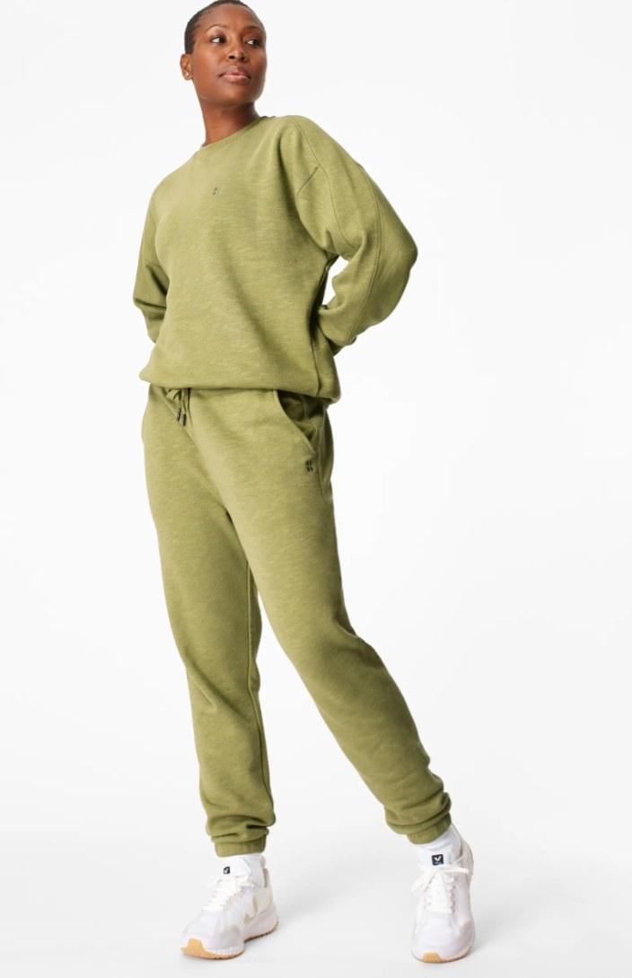 Model in the sweatsuit in green