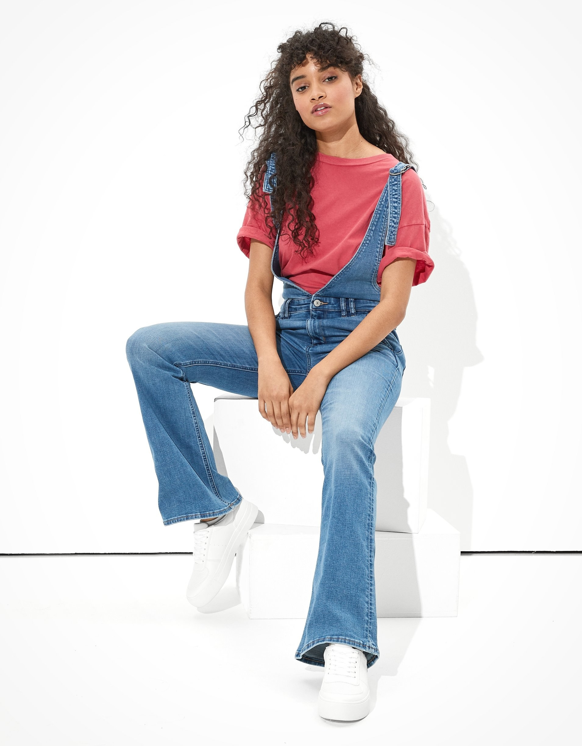 model in plunge-front overalls