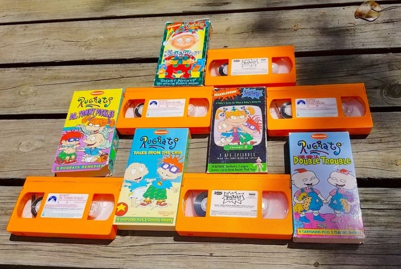 Various copies of Rugrats orange VHS tapes