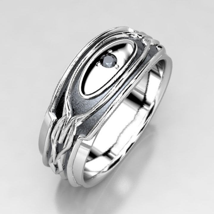 A black and silver band with geometric etchings and small black diamond at the center