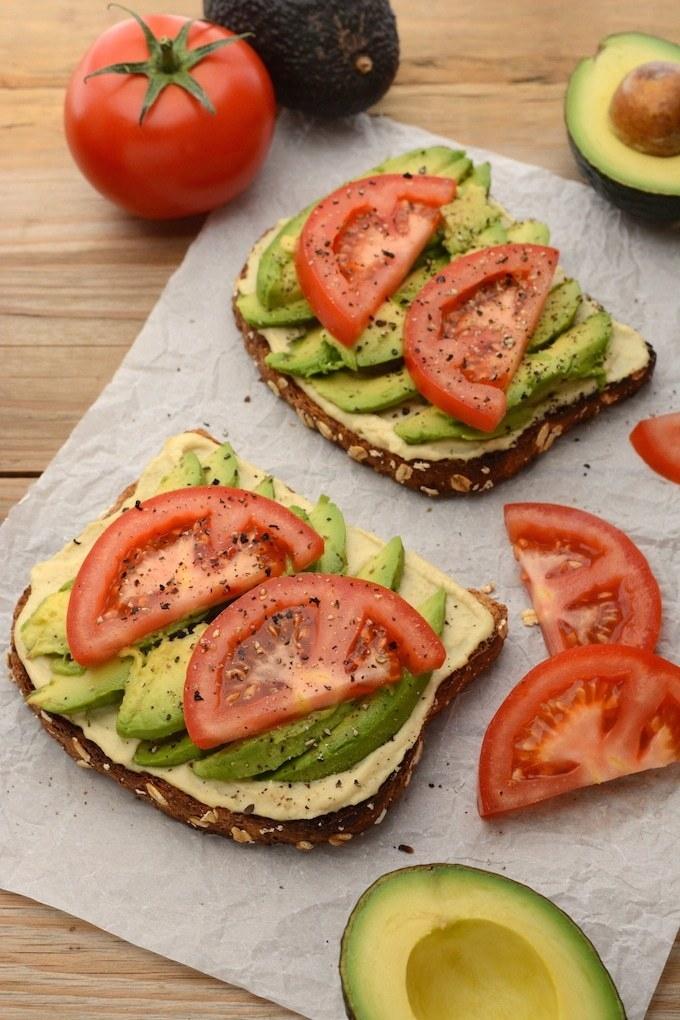 Hummus, avocado, and tomato toast