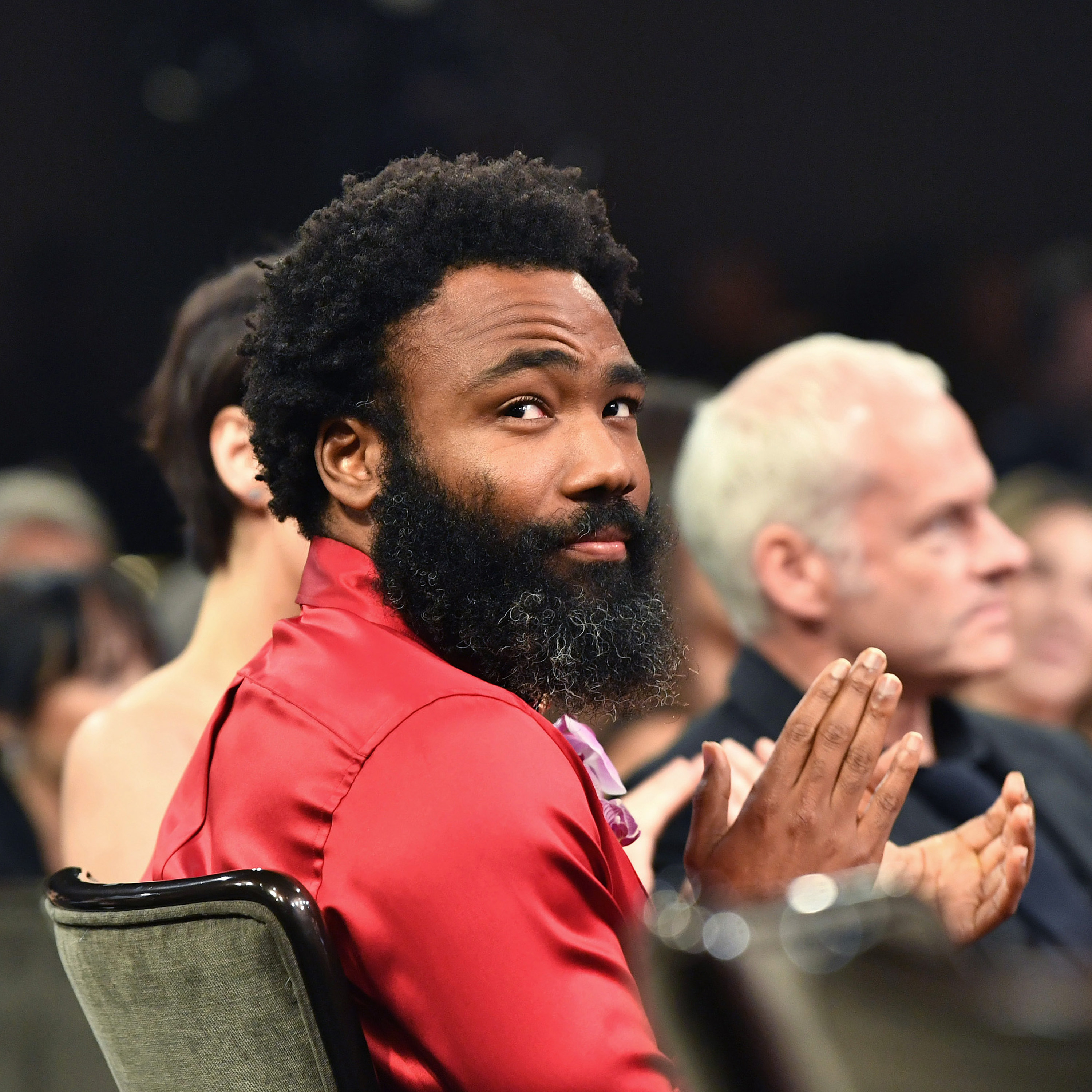 Donald Glover looks over his shoulder while sitting down at the British Academy Brittania Awards in October 2019