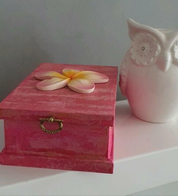 Small box with frangipani on the lid