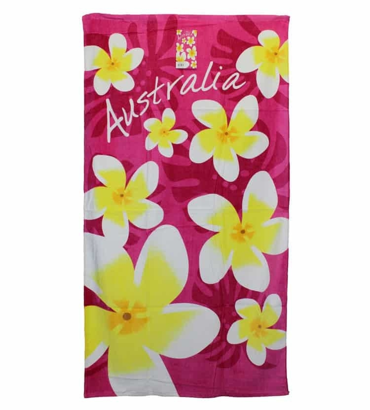 """Bright beach towel with frangipanis and the word """"Australia"""" written on it"""