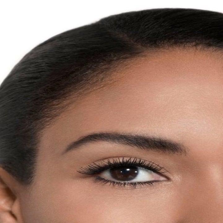 Model wearing the black volumizing mascara