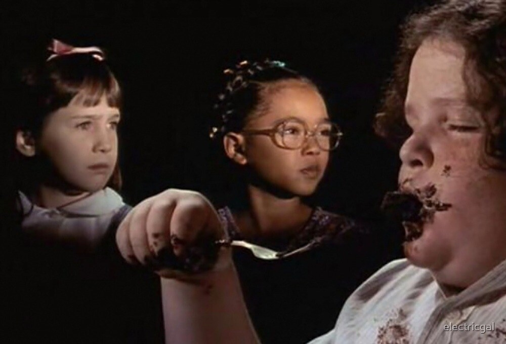 A screen shot of the cake scene from Matilda of Bruce eating a big piece of cake