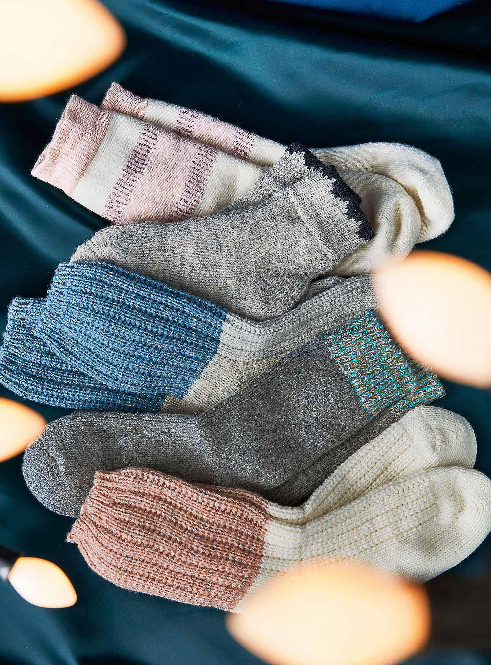 Five pairs of knit socks in a pile